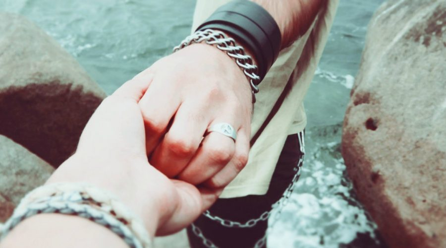 holding hands next to water