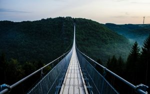 Trust with suspension bridge